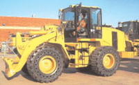 Loading Shovel fitted with SG Revolution SE traction pattern super cushion solid tyres